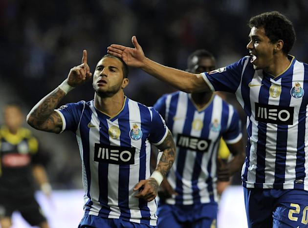 FC Porto's Ricardo Quaresma, left, celebrates scoring the opening goal against Arouca with Carlos Eduardo, from Brazil, in a Portuguese League soccer match at the Dragao stadium, in Porto, Portuga