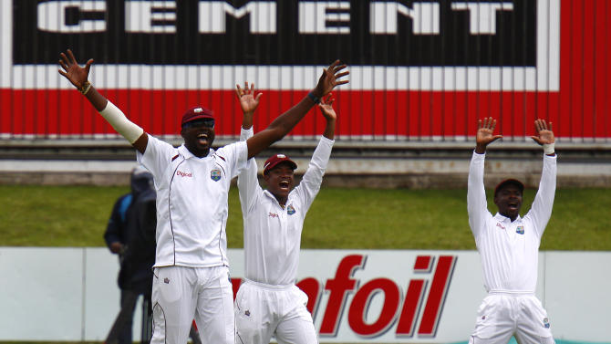 West Indies' Suliaman Benn appeals for LBW during the second cricket test against South Africa, in Port Elizabeth, South Africa, Friday, Dec. 26, 2014. (AP Photo/Michael Sheehan)