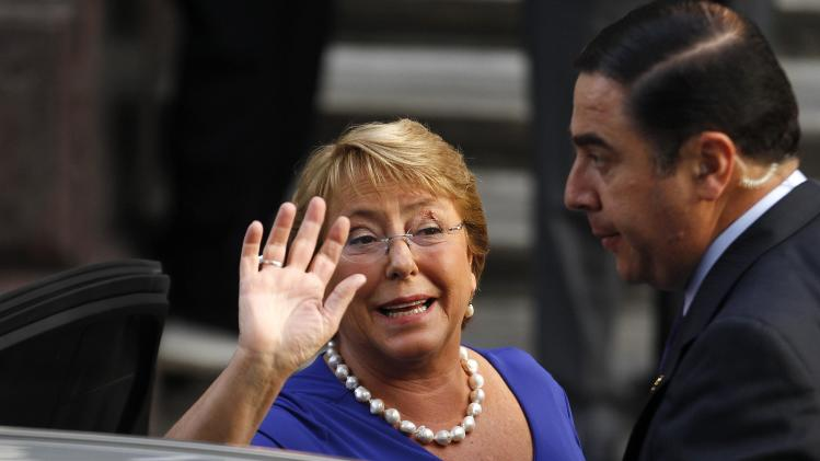 Chile's President-elect Michelle Bachelet waves to the media as she arrives to meet with authorities in Santiago