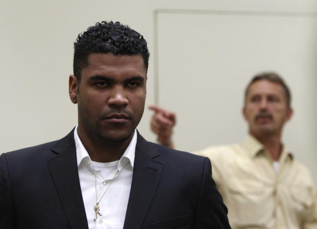 Bayern Munich defender Breno stands next to a German police officer in a court room in Munich