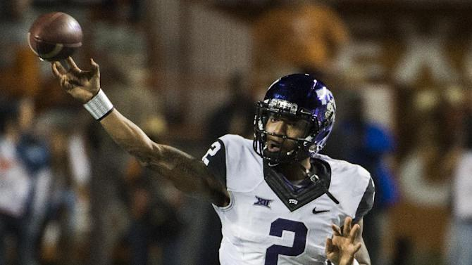 TCU quarterback Corry O'Meally (2) throws a pass during the first half of an NCAA college football game against Texas, Thursday, Nov. 27, 2014, in Austin, Texas. (AP Photo/Ashley Landis)