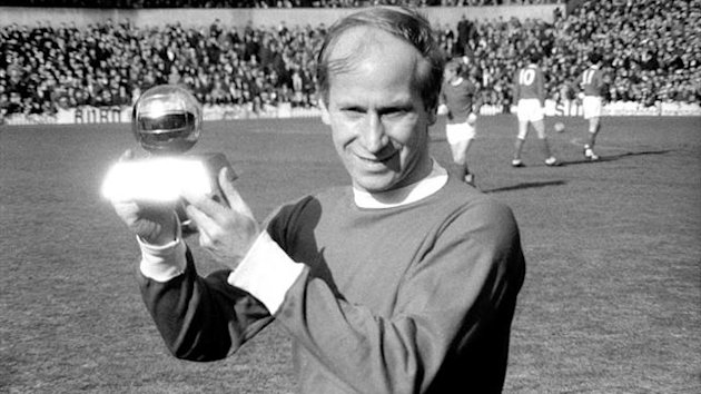 Manchester United's Bobby Charlton lifts the 1966 European Footballer of the Year trophy (PA)