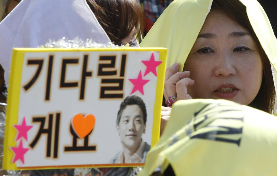 Asian fans wait for South Korean pop singer Rain before Rain enters the army to serve in front of an army training center in Uijeongbu, north of of Seoul, South Korea, Tuesday, Oct. 11, 2011. (AP Photo/ Lee Jin-man)