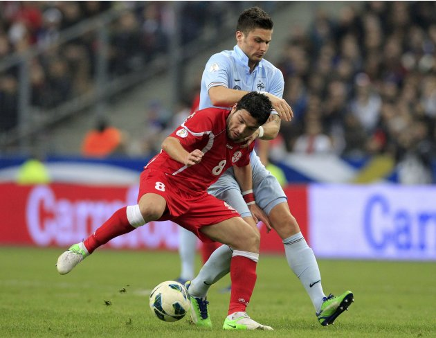 France's Giroud challenges Georgia's Davshvili during their 2014 World Cup qualifying match at the Stade de France stadium in Saint-Denis