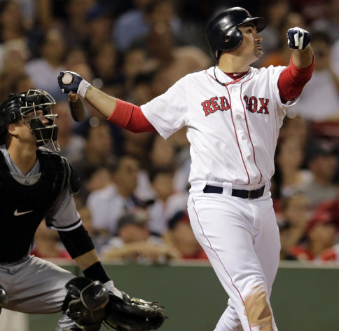 Boston Red Sox&#39;s Adrian Gonzalez watchs the flight of his three-run home run in the eighth inning of a baseball game against the Chicago White Sox at Fenway Park in Boston, Monday, July 16, 2012. At left is White Sox catcher A.J. Pierzynski. (AP Photo/Charles Krupa)