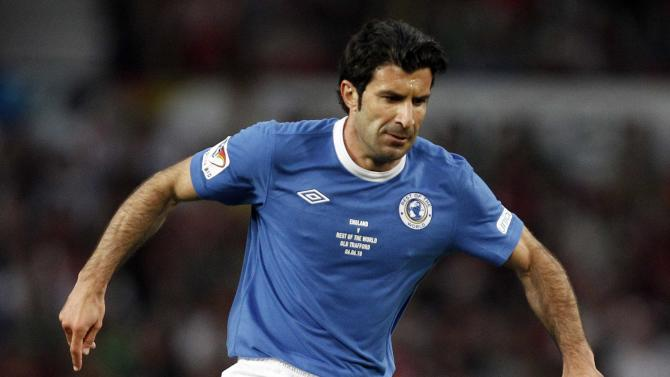 File photo of Portuguese former soccer player Figo running with the ball during a UNICEF Soccer Aid charity match at Old Trafford in Manchester