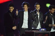 Harry Styles (second left) and his One Direction bandmates at the BRIT Awards in London last week. Stiles received the dubious honour of villain of they year while his group One Direction were voted worst band by influential music magazine NME at its annual awards show last night