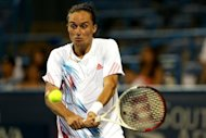 Ukraine's Alexandr Dolgopolov returns a shot to Germany's Tommy Haas during their Citi Open final on August 5. Dolgopolov survived a three-hour rain interruption to claim his second career title with a 6-7 (7/9), 6-4, 6-1 win over Haas at the ATP hardcourt event
