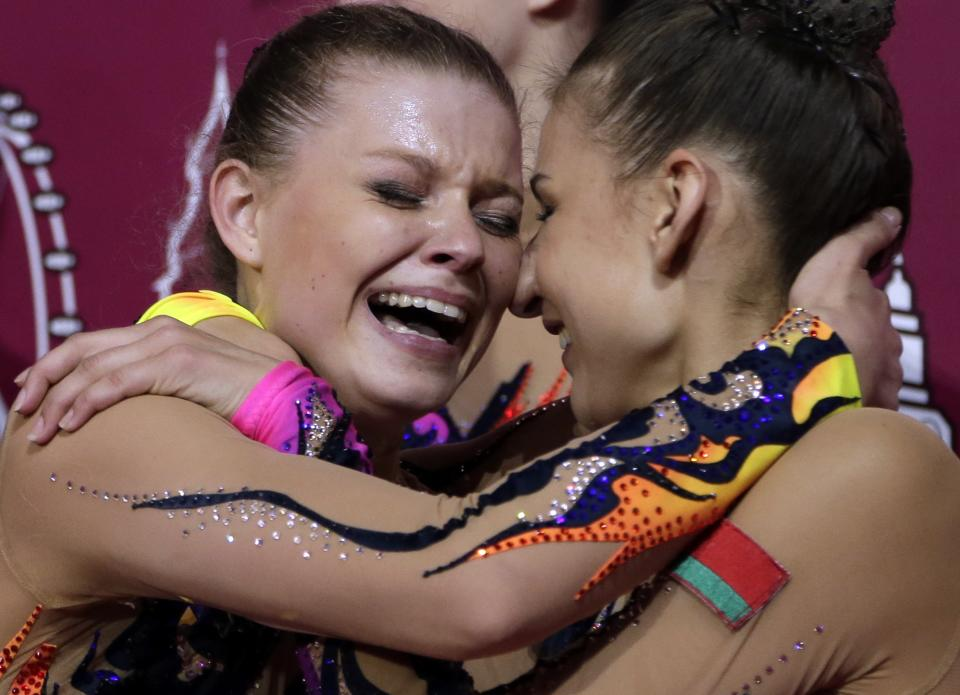 Members of the silver medallist team from Belarus celebrate after results were announced for the rhythmic gymnastics group all-around final at the 2012 Summer Olympics, Sunday, Aug. 12, 2012, in London. (AP Photo/Gregory Bull)