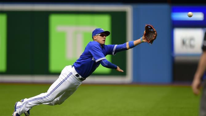 Toronto Blue Jays second baseman Ryan Goins dives but can't come up with the catch on a single by Chicago White Sox's Adam LaRoche during sixth inning of a baseball game in Toronto, Wednesday, May 27, 2015. (Frank Gunn/The Canadian Press via AP) MANDATORY CREDIT
