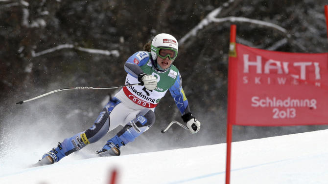 Leanne Smith, of the United States, speeds down the course during training for the women's downhill, at the Alpine skiing world championships in Schladming, Austria, Thursday, Feb.7, 2013. (AP Photo/Luca Bruno)