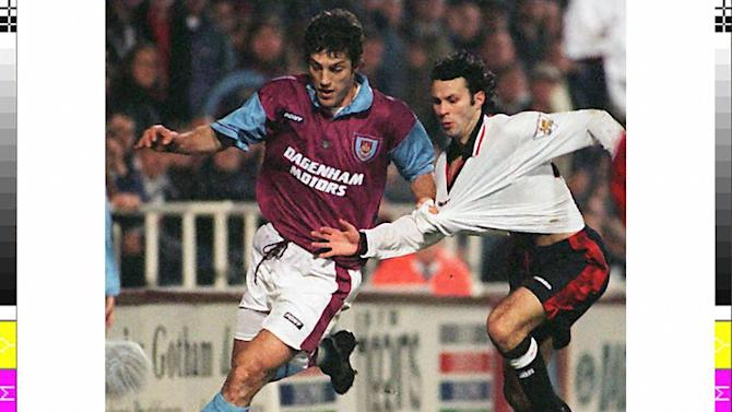 Slaven Bilic (L) pictured when he played for West Ham during a match against Manchester United