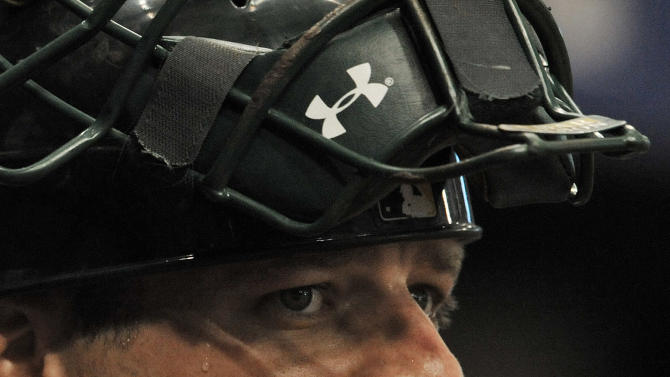 Oakland Athletics catcher Stephen Vogt stands in the dugout during a baseball game against the Tampa Bay Rays Friday, May 22, 2015, in St. Petersburg, Fla. (AP Photo/Steve Nesius)