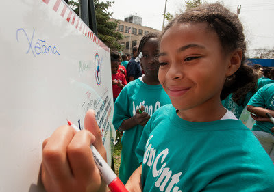 Children in The Action Center's summer program in Far Rockaways, N.Y., line up to sign the preparedness pledge a Save the Children Prep Rally. Photo...