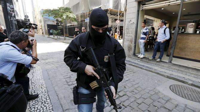 A federal police officer leaves the headquarters of Eletrobras' Eletronuclear division in Rio de Janeiro