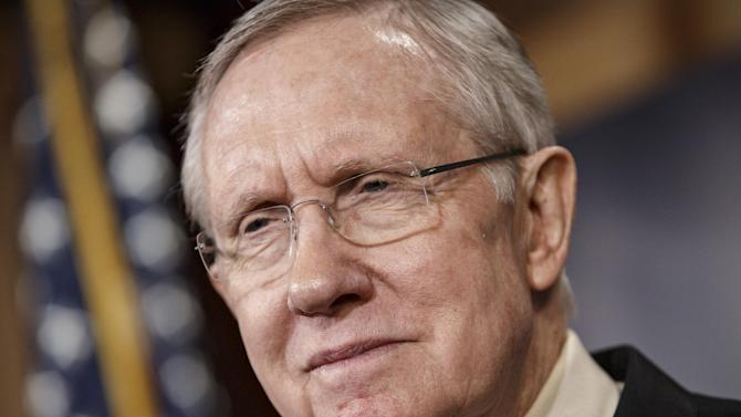 Senate Majority Leader Harry Reid, D-Nev., meets with reporters to urge passage of legislation to restore unemployment insurance benefits which expired Dec. 28, at the Capitol in Washington, Thursday, Jan. 9, 2014. (AP Photo/J. Scott Applewhite)