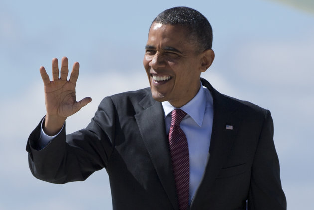 President Barack Obama waves as he arrives at General Mitchell International Airport on Air Force One, Saturday, Sept. 22, 2012, in Milwaukee. (AP Photo/Carolyn Kaster)