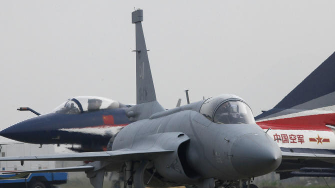 In this photo taken on Tuesday, Nov. 16, 2010, an FC-1 Xiaolong multirole fighter parks after demonstration at the 8th China International Aviation and Aerospace Exhibition (Zhuhai Airshow) in Zhuhai, southern China. China is emerging as a competitor in the international arms market, offering increasingly sophisticated fighter jets, missiles and equipment that are beginning to rival Russia and other longtime exporters.  (AP Photo/Kin Cheung)