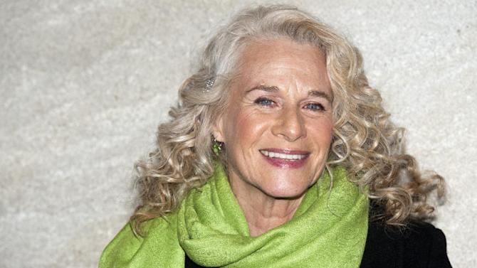 """FILE - In this Nov. 30, 2011 file photo, musician Carole King attends the Rockefeller Center Christmas tree lighting, in New York. King, now a best-selling author, doubts she will ever write another song and suggested that her 2010 """"Troubadours Reunion"""" concert tour with James Taylor would be her last. She recently released a memoir called, """"A Natural Woman.""""  (AP Photo/Charles Sykes, file)"""