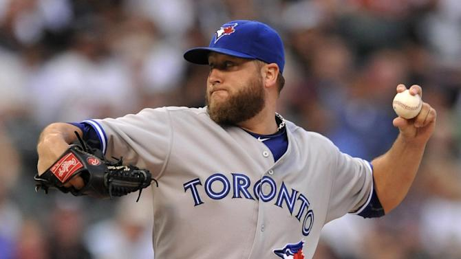 Toronto Blue Jays starter Mark Buehrle delivers a pitch during the first inning of a baseball game against the Chicago White Sox Monday, July 6, 2015 in Chicago. (AP Photo/Paul Beaty)
