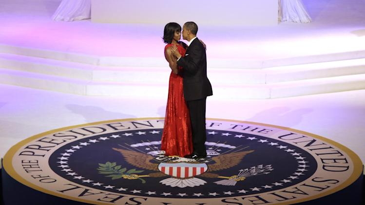 President Barack Obama and first lady Michelle Obama dance during the Commander-In-Chief Inaugural ball at the Washington Convention Center during the 57th Presidential Inauguration Monday, Jan. 21, 2013 in Washington.  (AP Photo/ Evan Vucci)