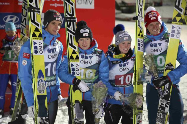 Schlierenzauer, Iraschko, Seigfriedsberger and Morgensstern pose after placing second in the FIS World Cup ski jumping mixed team competition in Lillehammer