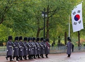 British military personnel march on the Mall outside…