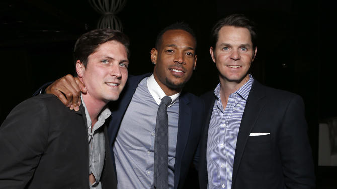"""Open Road's Ben Cotner, Co-Writer Marlon Wayans and Open Roads Film Executive Jason Cassidy attend the premiere of """"A Haunted House"""" at the Arclight Hollywood on Thursday, Jan. 3, 2013, in Los Angeles. (Photo by Todd Williamson/Invision/AP)"""