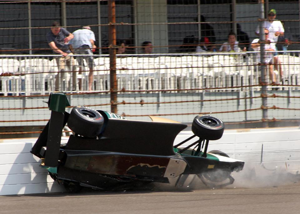 The car driven by IndyCar driver Ed Carpenter slams into the wall the on the second turn during his second qualification run on the first day of qualifications for the Indianapolis 500 auto race at the Indianapolis Motor Speedway in Indianapolis, Saturday, May 19, 2012. (AP Photo/Mike Fair)