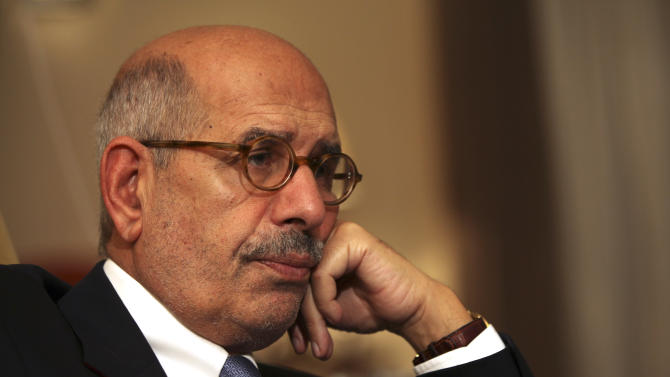 FILE - In this Saturday, Nov. 24, 2013 file photo, leading democracy advocate Mohammed ElBaradei speaks to a handful of journalists including the Associated Press, at his home on the outskirts of Cairo, Egypt. Security was beefed up around Egypt's opposition leaders on Thursday, Feb. 7, 2013 after several hardline Muslim clerics issued religious edicts calling for them to be killed, raising fears of assassinations similar to that of a Tunisian opposition leader gunned down a day earlier. A security official said ElBaradei's home and several other leaders' homes will be put under observation for their protection.(AP Photo/Thomas Hartwell, File)