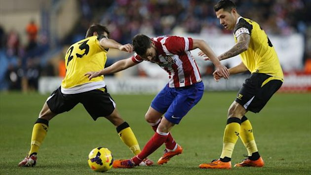 "Atletico Madrid's David Villa fights for the ball with Sevilla's Jorge Andujar Moreno ""Koke"" (L) and Victor Machin ""Vitolo"" during their Spanish First Division match (Reuters)"