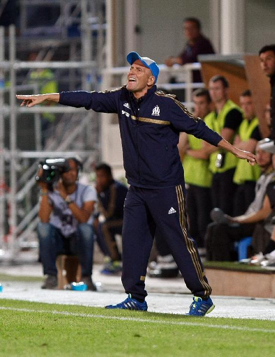 Marseille's French coach Elie Baup reacts during their League One soccer match against Reims, at the Velodrome Stadium, in Marseille, southern France, Saturday, Oct. 26, 2013