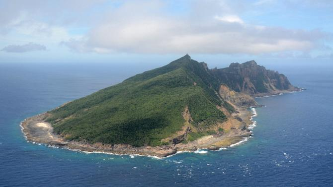 FILE - This June 2011 file photo shows Uotsuri Island, one of the islands of Senkaku in Japanese and Diaoyu in Chinese, in the East China Sea. Tokyo officials are set to head by boat Saturday night, Sept. 1, 2012 to the tiny islands controlled by Japan but claimed by China and Taiwan to carry out a survey before buying the islands, heating up a longtime territorial dispute. Tokyo Gov. Shintaro Ishihara has already raised 1.45 billion yen ($19 million) in donations to buy the islands from Japanese owners. (AP Photo/Kyodo News) JAPAN OUT, MANDATORY CREDIT, NO LICENSING IN CHINA, HONG KONG, JAPAN, SOUTH KOREA AND FRANCE