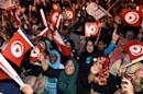 Tunisian Ennadha Party supporters wave flags as they wait for the party's leader to give a speech on October 27, 2014 in Tunis following the legislative election