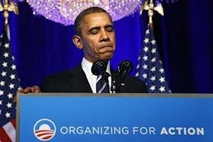 U.S. President Obama pauses while delivering remarks on Obamacare at an Organizing for Action grassroots supporter event in Washington