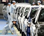 This file photo shows workers checking Toyota Motor's cars at a plant of the company's subsidiary Central Motor at Ohira village in Miyagi prefecture, northern Japan, in 2011. Confidence among large Japanese manufacturers worsened in the quarter ended September, the Bank of Japan said on Monday as businesses suffer amid a territorial spat with China