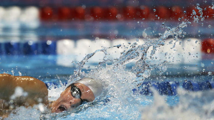 Dana Vollmer swims in the women's 100-meter freestyle preliminaries at the U.S. Olympic swimming trials, Friday, June 29, 2012, in Omaha, Neb. (AP Photo/Mark Humphrey)