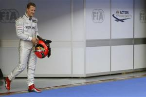 File photo of Mercedes Formula One driver Schumacher walking after qualifying session of the Malaysian F1 Grand Prix outside Kuala Lumpur