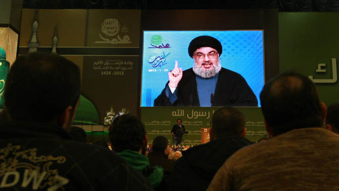 """Hezbollah leader Sheik Hassan Nasrallah speaks via a video link, during a ceremony to mark Islam's Prophet Muhammad's birth in the southern suburbs of Beirut, Lebanon, Friday, Jan. 25, 2013. Nasrallah, a staunch ally of the Syrian regime, said those who had dreamed about """"dramatic changes"""" taking place in Syria should let go of their dreams. He said all military, political and international indications showed that President Bashar Assad's regime cannot be defeated. (AP Photo/Bilal Hussein)"""