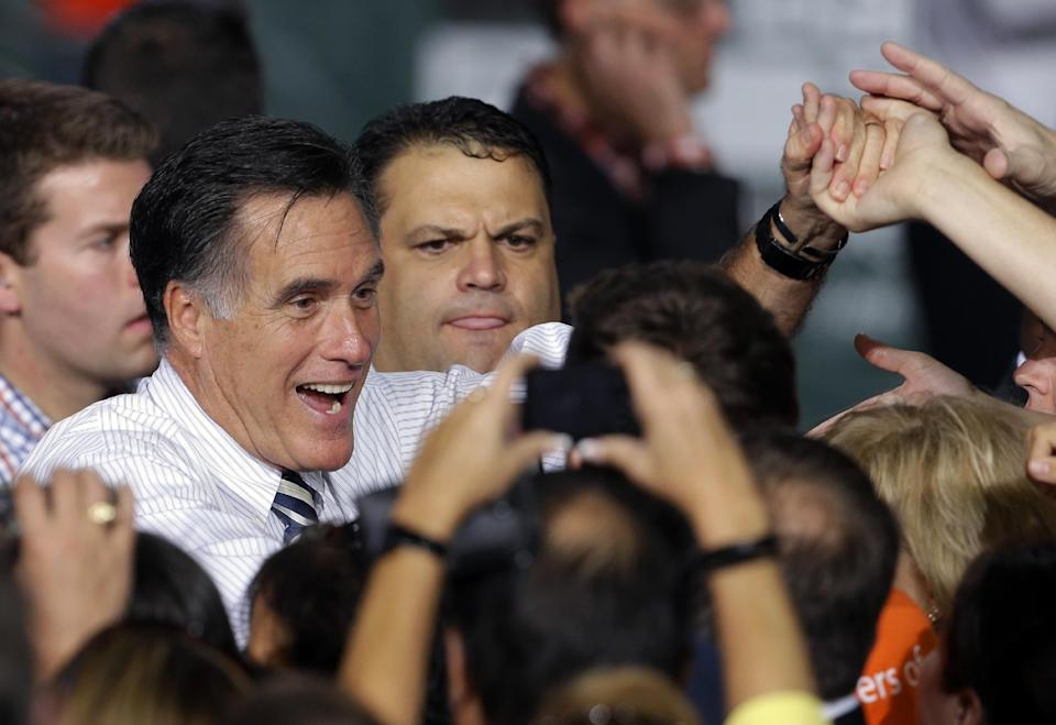 Republican presidential candidate, former Massachusetts Gov. Mitt Romney shakes hands with supporters during a campaign stop at the University of Miami, Wednesday, Oct. 31, 2012, in Coral Gables, Fla. (AP Photo/Lynne Sladky)