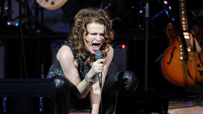 """Actress and singer Sandra Bernhard performs at """"The Music of Prince"""" tribute concert at Carnegie Hall on Thursday March 7, 2013 in New York. (Photo by Evan Agostini/Invision/AP)"""