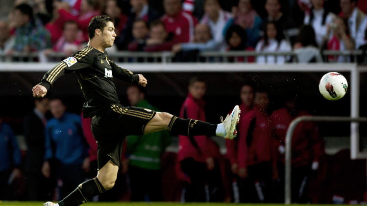 Real Madrid 's Cristiano Ronaldo, from Portugal, controls the ball during a Spanish La Liga soccer match against FC Granada at the Carmenes stadium, in Granada, Spain, Saturday, May 5, 2012. (AP Photo/Daniel Tejedor)