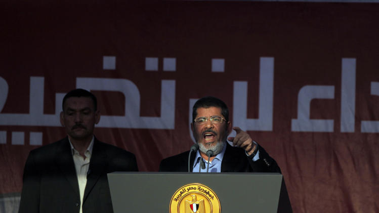 Egypt's President-elect Mohammed Morsi talks to his supporters at Tahrir Square, the focal point of Egyptian uprising, in Cairo, Egypt, Friday, June 29, 2012. In front of tens of thousands of cheering supporters, Egypt's first Islamist and civilian president-elect vowed that nobody can take away his authority and symbolically read an oath of office on the eve of his official inauguration. (AP Photo/Amr Nabil)