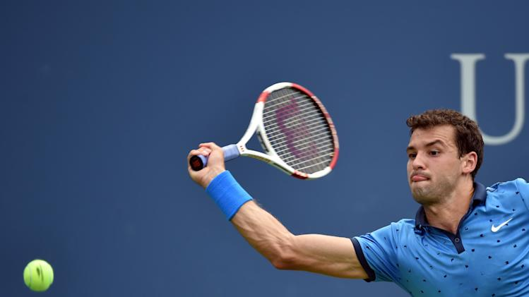 Grigor Dimitrov of Bulgaria returns a shot to Gael Monfils of France during their US Open men's singles match, in New York, on September 2, 2014