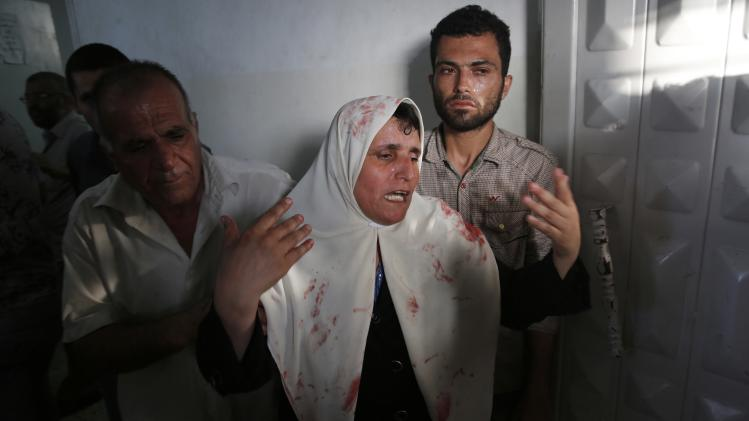 Palestinian woman grieves at a morgue in Gaza City