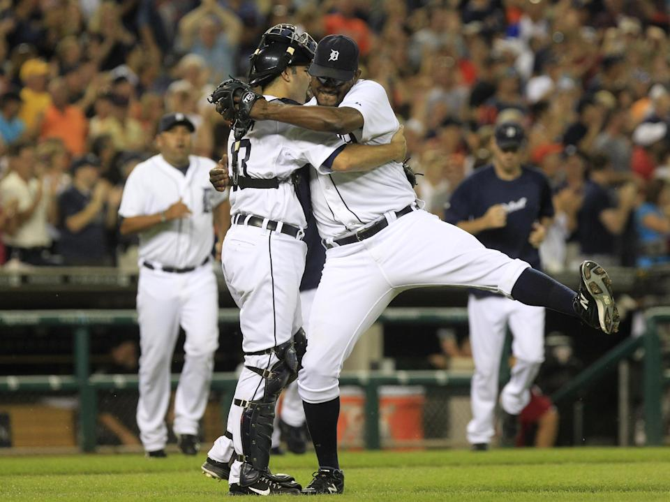 Detroit Tigers relief pitcher Jose Valverde celebrates the Tigers' 4-2 win over the Chicago White Sox with catcher Alex Avila in the ninth inning of a baseball game in Detroit, Friday, July 20, 2012. (AP Photo/Carlos Osorio)