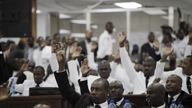 Senators and members of the Parliament vote for a proposal during the Special Bicameral Commission for the election of the Provisional president of the Republic in the Haitian Parliament in Port-au-Prince, Haiti
