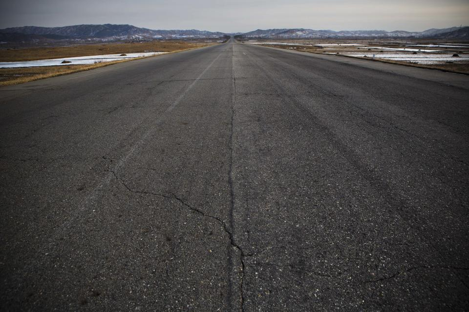 In this Feb. 24, 2013 photo, a highway on the outskirts of Pyongyang, North Korea is empty of traffic. (AP Photo/David Guttenfelder)