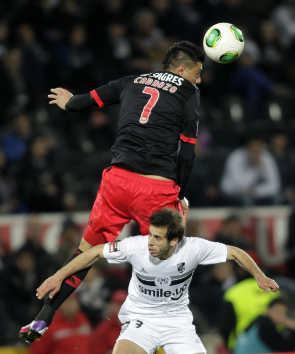 Guimaraes' Luis Rocha battles for the ball with Benfica's Cardozo during their Portuguese Premier League soccer match in Guimaraes