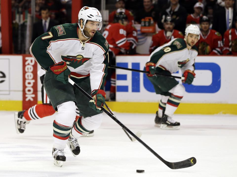 Minnesota Wild's Matt Cullen (7) controls the puck as he looks to pass during the first period of Game 5 of an NHL hockey Stanley Cup first-round playoff series against the Chicago Blackhawks in Chicago, Thursday, May 9, 2013. (AP Photo/Nam Y. Huh)